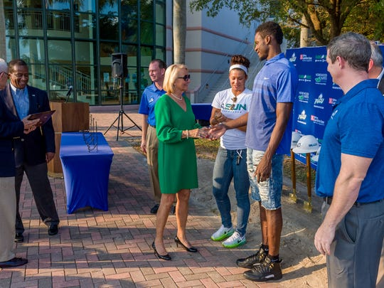 Donna and Jim Sublett greet FGCU coaches, players and administrators during the Alico Arena expansion project groundbreaking Nov. 4, 2016.  The Subletts were one of three couples to donate $1 million to the project.