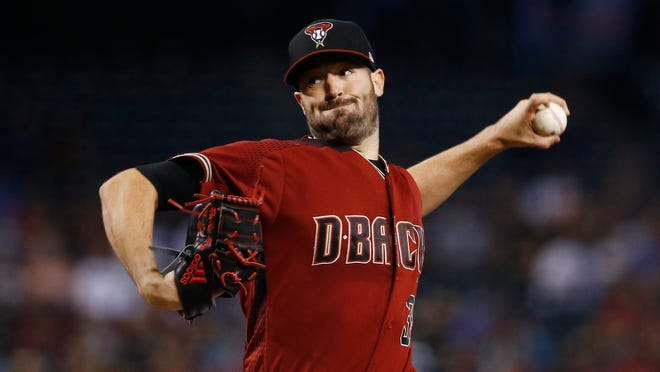 Arizona Diamondbacks' Robbie Ray throws a pitch against the Milwaukee Brewers during the first inning of a baseball game Sunday, June 11, 2017, in Phoenix. (AP Photo/Ross D. Franklin)