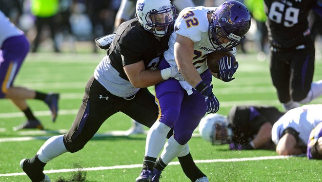 USF's #33 Clint Wilson tackles MSU's #32 Zach Knox during football action at the Bob Young Field in Sioux Falls, S.D., Saturday, Nov. 7, 2015.