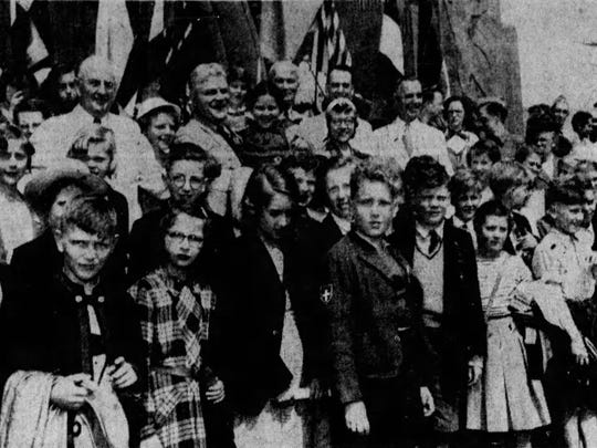 In June 1951, Mayor Albert D. Cash, middle, greeted the student delegates from seven nations for the first Children's International Summer Camp. To the right of the mayor is CISV founder Doris Twitchell Allen.