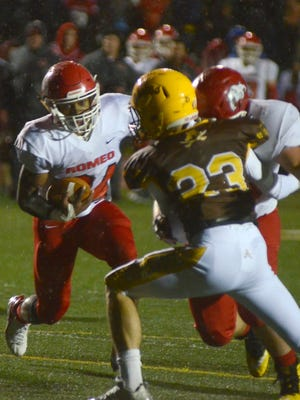 Romeo High running back Malik Jones, left, begins a touchdown run as Rochester Adams Cole Mitchell is blocked in the first half during a playoff game on Friday, Oct. 27, 2017.