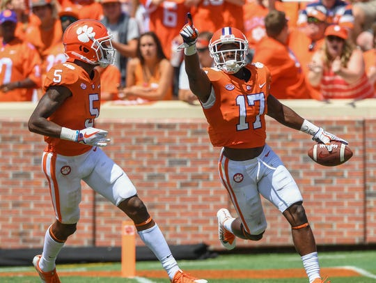 Clemson wide receiver Cornell Powell (17) scores against