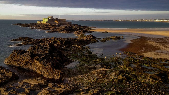 The prison island at St. Malo during low tide.