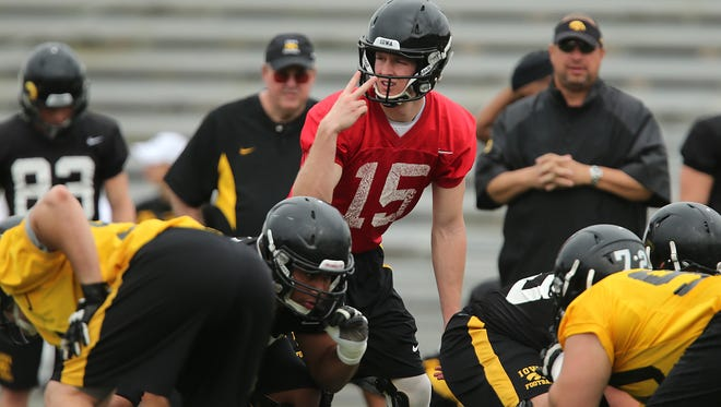Iowa quarterback runs a play in practice while wearing a knee brace on Saturday, Dec. 28, 2013, at the University of Tampa in Tampa, Florida. (Bryon Houlgrave/The Register)