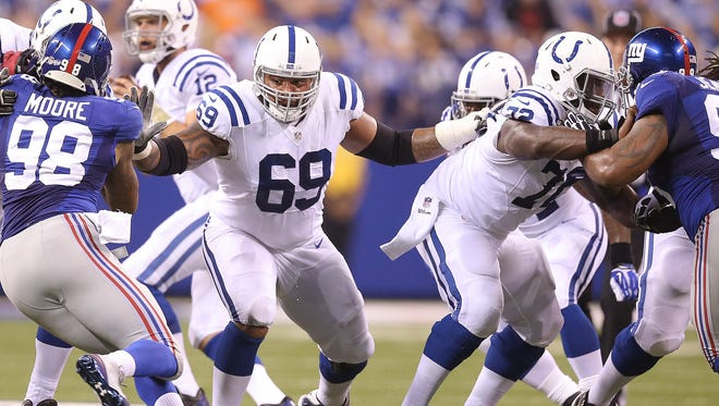 Indianapolis Colts Hugh Thorton,#69, and Jonotthan Harrison,right, block for QB Andrew Luck in the first half of their preseason Saturday, August 16, 2014, evening at Lucas Oil Stadium.