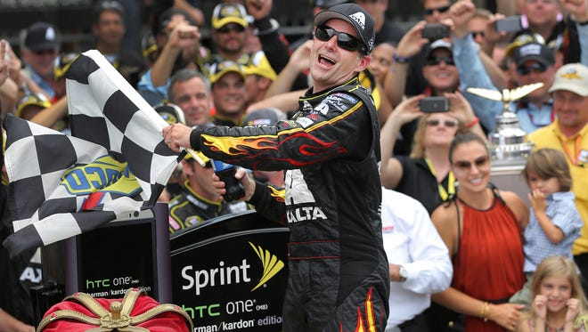 Jeff Gordon's crew work a quick pitstop on lap 98 to keep him in the hunt at the Brickyard 400 race at the Indianapolis Motor Speedway Sunday, July 27, 2014