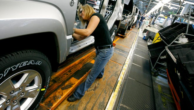 In this Nov. 16, 2011 file photo, Pam Bialecki works on a 2012 Jeep Wrangler at the Chrysler Toledo Assembly complex