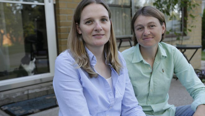 Barbara Webb, 33, of Madison Heights, Mich., left, sits with her wife, Kristen Lasecki, 33, on Sept. 2, 2014.