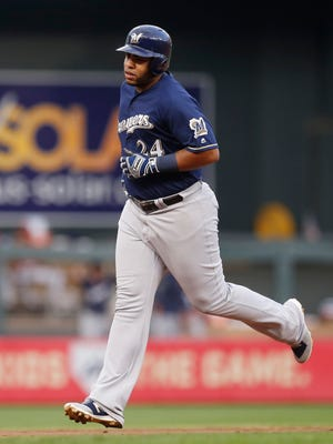 Jesus Aguilar circles the bases after blasting a two-run homer for the Brewers in the third inning against the Twins on Friday night.