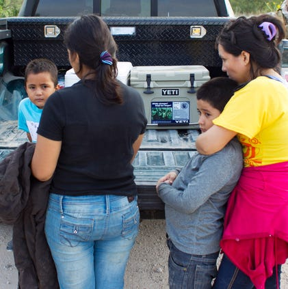 A group of two Honduran women and two young children sit near the back of a pick-up truck near after being apprehended by Game Wardens with Texas Parks & Wildlife Department. A surge of thousands of migrants from Central America --?? many fleeing gang violence and upheaval in their country --?? has taxed detention resources around the country.