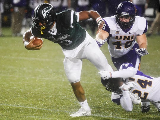 Portland State running back David Jones (3) is brought down by Northern Iowa defensive back Tim Kilfoy (24) and linebacker Jared Farley (46) during the first half of a second-round NCAA FCS playoff game at Providence Park on Saturday, Dec. 5, 2015, in Portland.