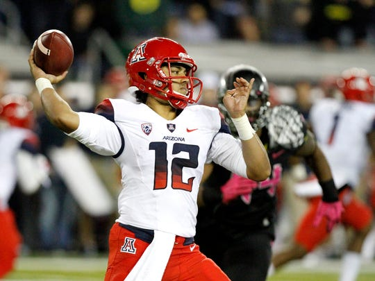 Arizona quarterback passed for 287 yards and a touchdown in the Wildcats' 31-24 victory over Oregon on Oct. 2 at Autzen Stadium.