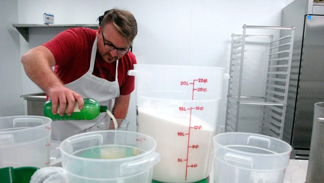 Chef Zac Caldwell, of Caldwell's Quirky Cookery, measures out lemon juice for his jam recipes in Chef Space, a commercial kitchen space for rent to culinary entrepreneurs, on West Muhammed Ali Blvd.  April 07, 2016