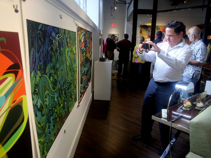 David Hochberg of Katonah takes a photo of a painting