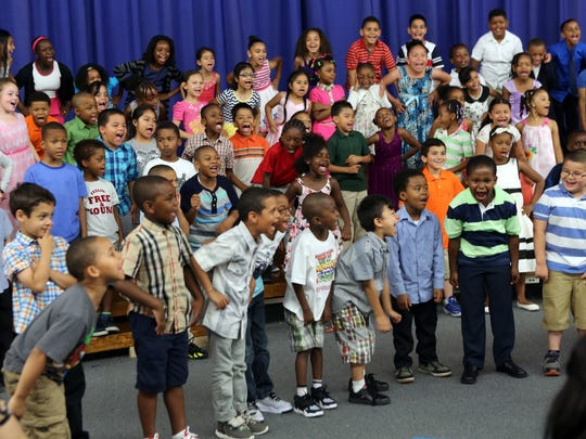 Students from Yonker's Cross Hill Academy school perform