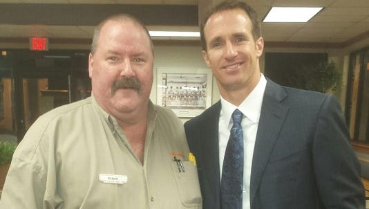 Whataburger manager Byron Smith poses with New Orleans Saints quarterback Drew Brees who stopped at the Shreveport restaurant on Jewell Avenue on Monday.