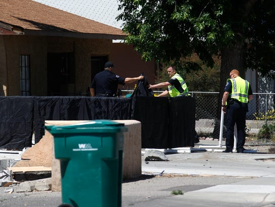 Farmington police officers secure a residence where a person was struck by a vehicle today on the 700 block of West Apache Street in Farmington.