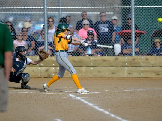 CMR's Madison Moore drives the ball to left field for