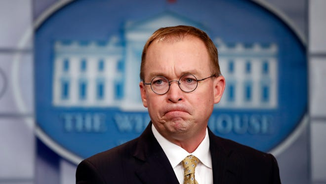 White House budget director Mick Mulvaney listens to a question during a press briefing at the White House Jan. 20.