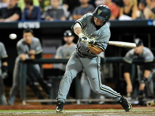 Vanderbilt's Nolan Rodgers swings a bat against Virginia during the 7th inning in the Game 2 of the College World Series finals at TD Ameritrade Park, Tuesday, June 23, 2015, in Omaha, Neb.