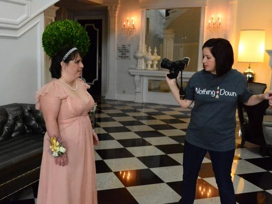"""Photographer Julie Willson (right) works with Stephanie DeCicco of Mays Landing (left) during the """"Down Syndrome is Beautiful"""" glamour photo shoot at Addison Park banquet hall in Aberdeen."""