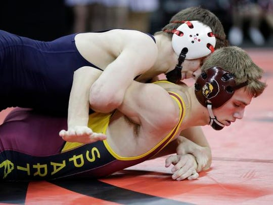 Luxemburg-Casco High School's Nathan Ronsman, bottom, wrestles against St. John's NW Mil. Ac/Br. Ac.'s Aidan Medora in their Division 2 126-lb quarterfinal match during the WIAA Individual Wrestling State Tournament Friday, February 24, 2017, at the Kohl Center in Madison, Wis. 