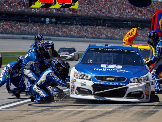 Dale Earnhardt Jr. (88) pits during the Camping World 500 auto race at Talladega Superspeedway, Sunday, May 7, 2017, in Talladega, Ala. (AP Photo/Butch Dill)