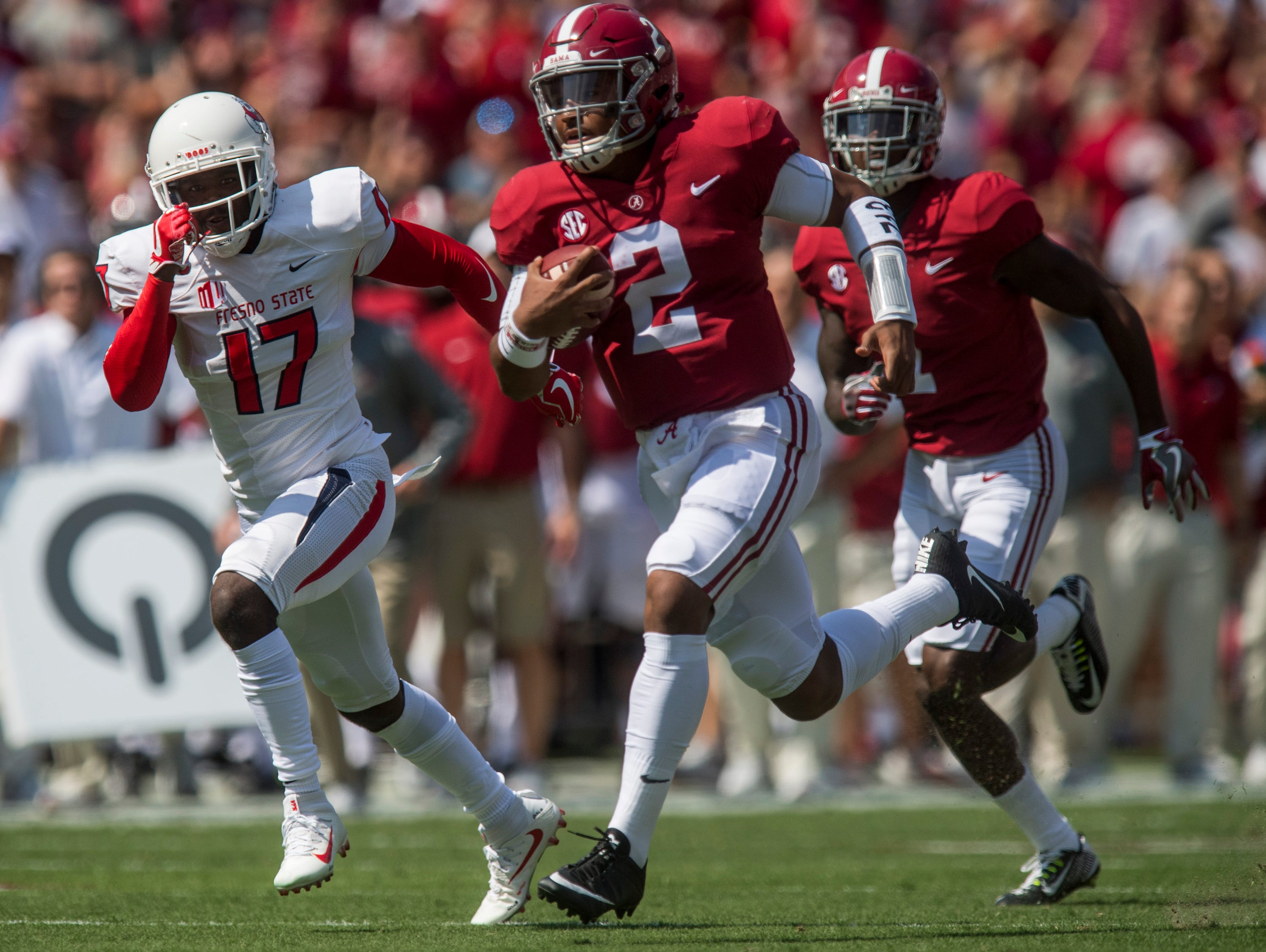 Alabama quarterback Jalen Hurts (2) gets by Fresno State defensive back Johnny Johnson, Jr. (17) for a first quarter touchdown at Bryant Denny Stadium in Tuscaloosa, Ala., on Saturday September 9, 2017. (Live from Tuscaloosa: Alabama vs. Colorado State.
