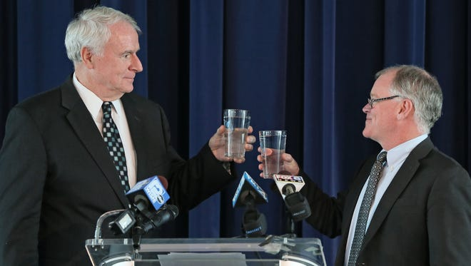 Milwaukee Mayor Tom Barrett (left) and Waukesha Mayor Shawn Reilly share a toast with glasses of Milwaukee water, as they announced that they have negotiated an agreement for the Milwaukee Water Works to provide a Lake Michigan water supply to the Waukesha Water Utility at a press event held at Discovery World on Milwaukee's lakefront.