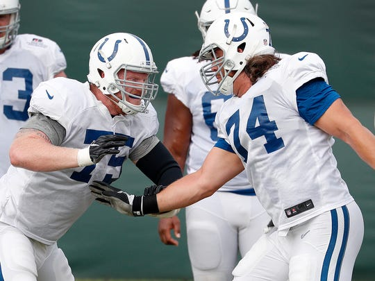 Indianapolis Colts offensive guard Jack Mewhort (75) works on  tackle Anthony Castonzo (74) during their training camp practice at the Colts complex on West 56th Street Friday morning August 11, 2017.
