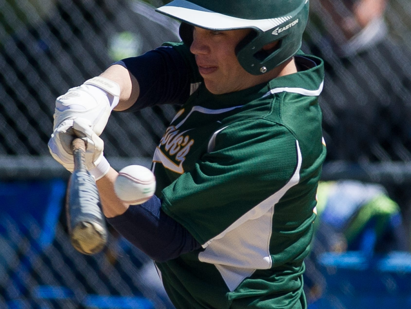 St. Mark's Tom Reich (6) swings for the ball in the first inning against Caesar Rodney.
