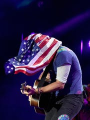 Chris Martin of Coldplay performs onstage during the