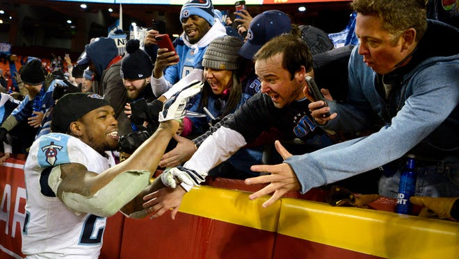 Titans running back Derrick Henry (22) celebrates with Titans fans after defeating the Chiefs 22-21 at Arrowhead Stadium Saturday, Jan. 6, 2018 in Kansas City , Mo.
