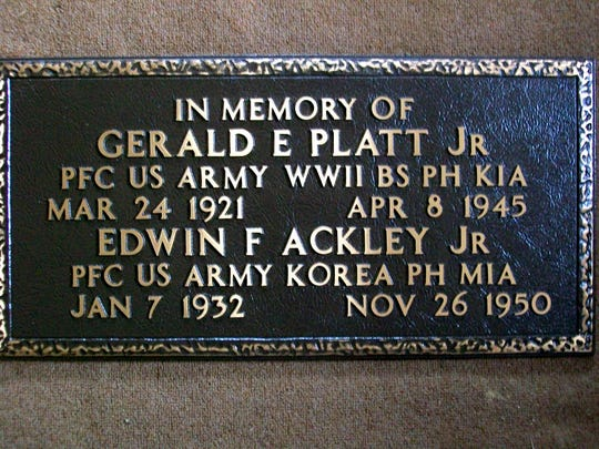 This memorial plaque, which honors two Southern Tier natives who were lost in war, was placed by the graves of their parents at Forest Lawn Cemetery in Elmira.