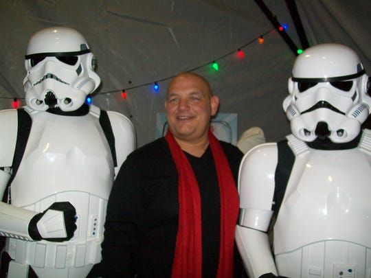 Mayor Samson D. Steinman (center) greets Imperial Stormtroopers