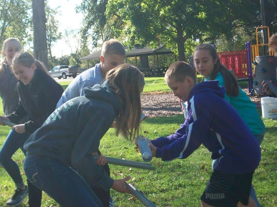 Members of the Youth Leadership Sandusky County Class of 2018 take part in a team-building exercise.