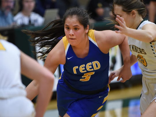 Reed's Vanessa Hernandez drives to the basket against Manogue in Tuesday's playoff game at Bishop Manogue.