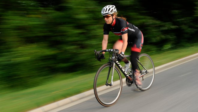 Patty Collins rides around Hains Point in Washington. She'll team with Amy Dixon in the Panasonic New York City Triathlon.