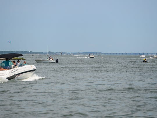 The Assawoman Bay is full of boaters and fisherman during the holiday week in Ocean City, Md. on July 3, 2017.