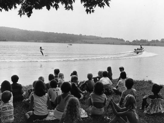 A Farragut summer school camp watches a jet skier at
