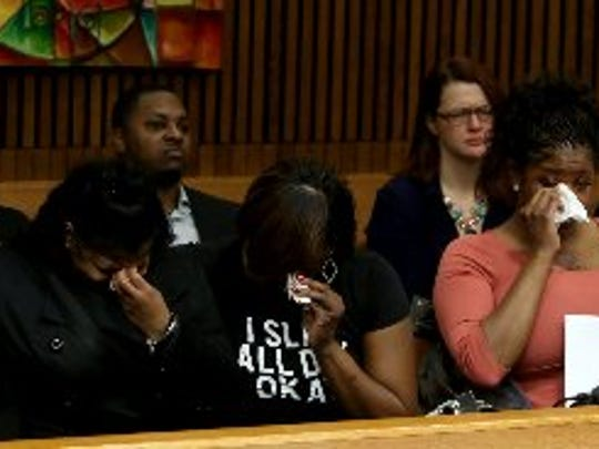 Darlene Savage (front row, third from left) the mother of 12-year-old Victoria Mack listens to Wayne County Assistant Prosecutor Mike Reynolds talk her daughter dying from Charles Cahill's drunk driving on July 27, 2016 in Sumter Township, Michigan.