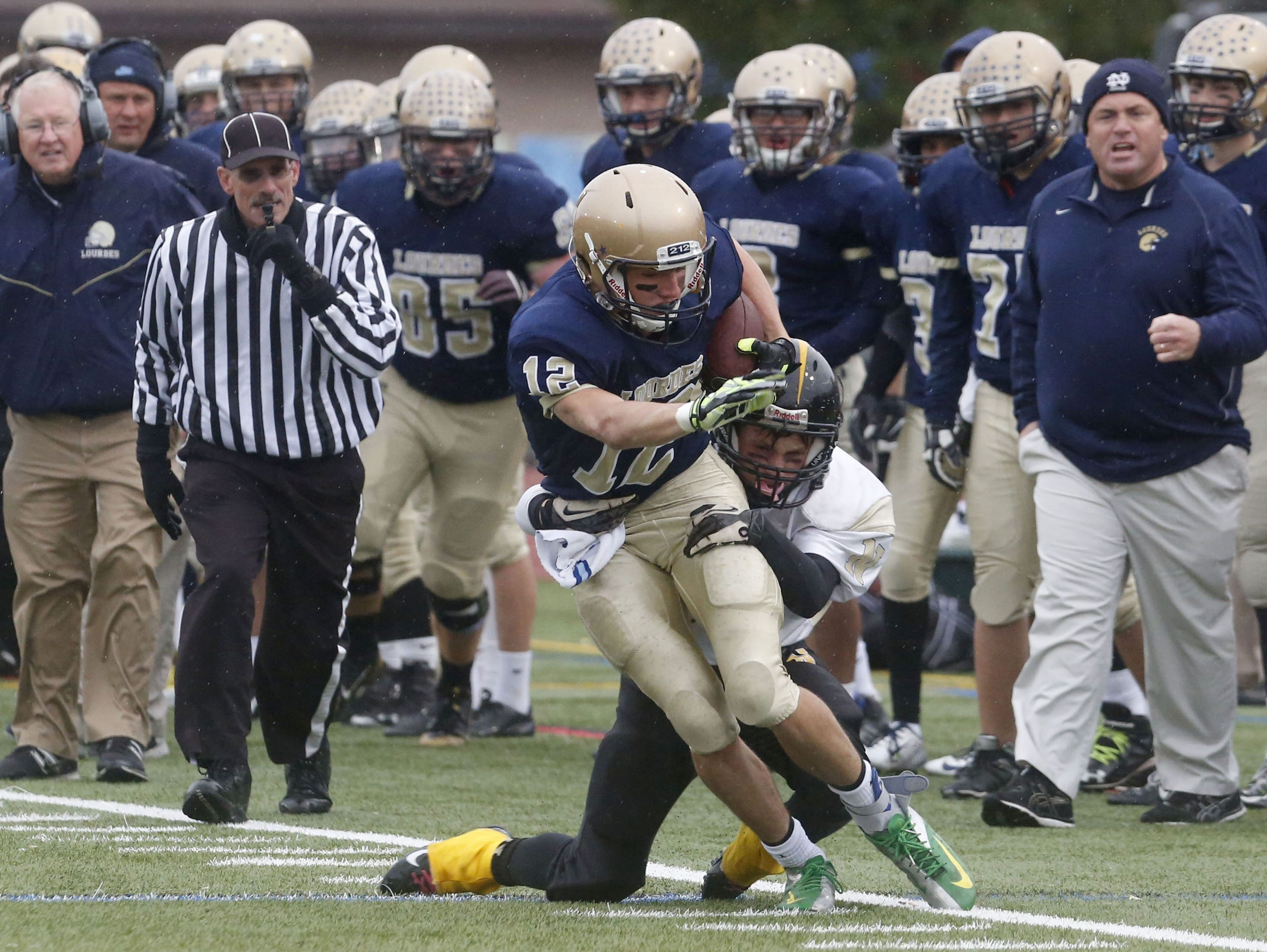 Our Lady of Lourdes High School's Luke Timm tries to break a tackle during last season's Section 1 Class B final against Nanuet.
