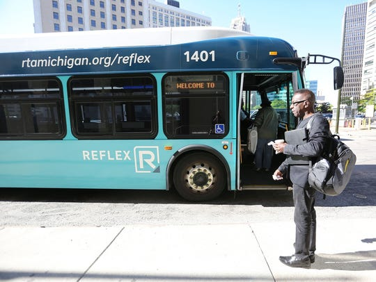 A SMART (Suburban Mobility Authority for Regional Transportation) bus picks up riders.
