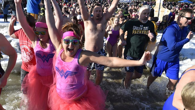 More than 800 revelers celebrate the new year on Jan. 1, 2017, with a quick dip into Lake Michigan in Jacksonport. The 32nd annual event on Monday is hosted at Lakeside Park by the Jacksonport Polar Bear Club.