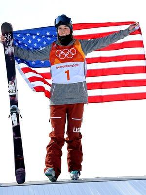Brita Sigourney (USA) celebrates winning bronze in the women's freestyle skiing halfpipe final.