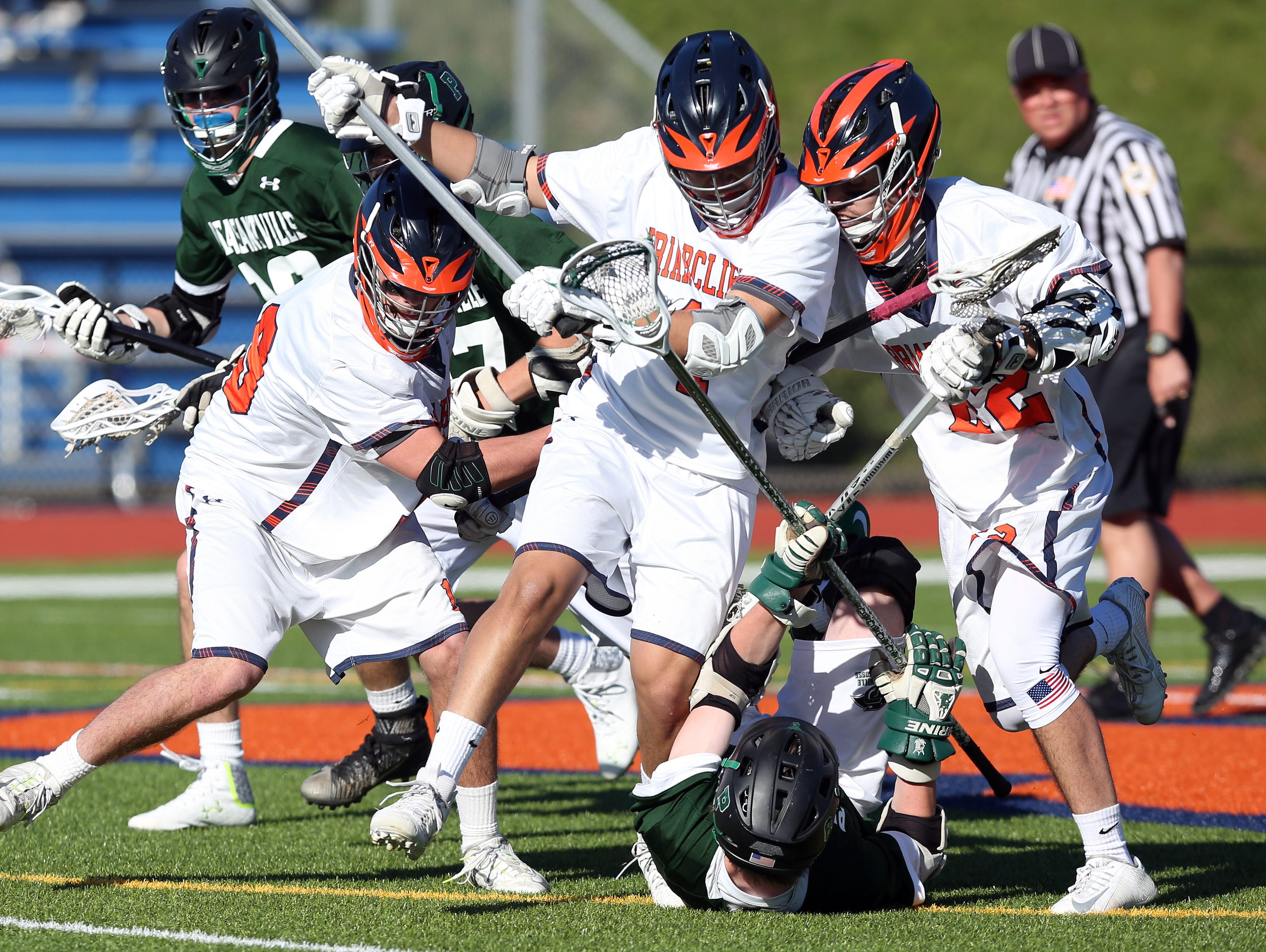 From left, Briracliff's Matt Hausman (9) Lucas Huffier (1) and John Plimpton (22) combine to steals the ball away from Pleasantville's Greg Driscoll (8) during a lacrosse game at Briarcliff High School April 20, 2016. Briarcliff won the game 8-7.