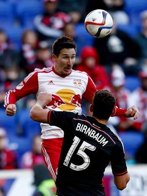 Sacha Kljestan of New York Red Bulls heads the ball in front of Steve Birnbaum of D.C. United.