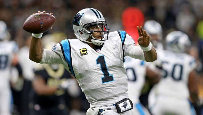 Carolina Panthers quarterback Cam Newton (1) makes a throw in the second quarter against the New Orleans Saints at the Mercedes-Benz Superdome.