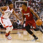 Jan 22, 2016; Toronto, Ontario, CAN; Miami Heat guard Josh Richardson (0) controls the ball against Toronto Raptors guard Kyle Lowry (7) during the first half at the Air Canada Centre. Mandatory Credit: John E. Sokolowski-USA TODAY Sports