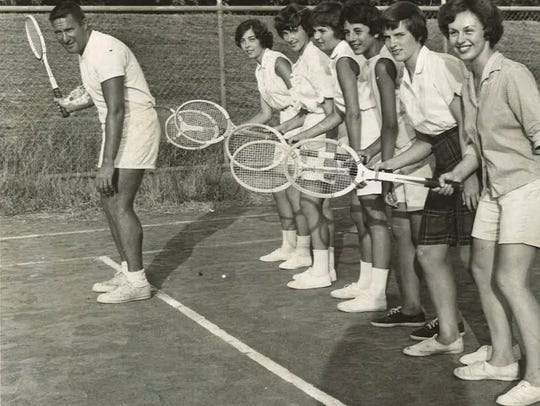 Fran Angeline instructs a group of tennis players at